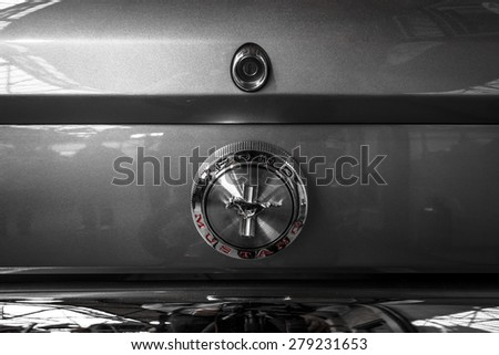 BERLIN - MAY 10, 2015: The logo on the trunk of a pony car Ford Mustang (first generation). Black and white. 28th Berlin-Brandenburg Oldtimer Day - stock photo