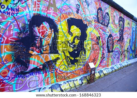 BERLIN - NOVEMBER 10: Fragment of East Side Gallery on November 10,2013 in Berlin. It's a 1.3 km long part of original Berlin Wall which collapsed in 1989 and now is the largest world graffiti gallery - stock photo