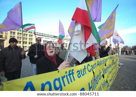 BERLIN - NOVEMBER 3: Iranian demonstrators in front of US embassy on Parizer Platz on November 3, 2011 in Berlin, Germany. Protesters want the US to protect Irani refugees inside Ashraf Camp, Iraq. - stock photo