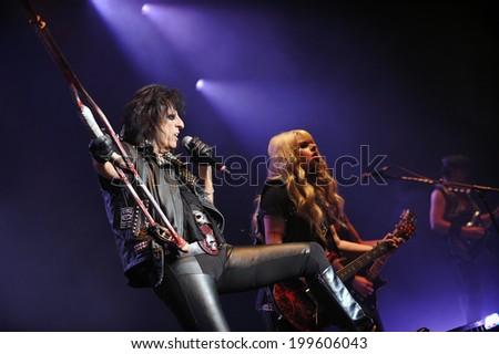 BERLIN - NOVEMBER 14: Legendary American rocker Alice Cooper (left) during his performance in Berlin, Germany, November 14, 2011. - stock photo