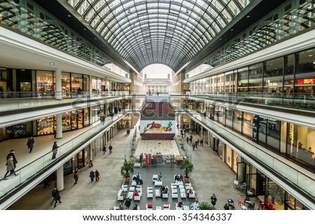 "BERLIN - NOVEMBER 30, 2015: The new shopping center ""Mall of Berlin"" at Potsdamer Platz. HDRi. - stock photo"