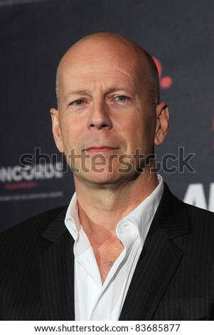 BERLIN - OCTOBER 18: Actor Bruce Willis attends a photocall presenting the movie RED at Regent Hotel on October 18, 2010 in Berlin, Germany. - stock photo