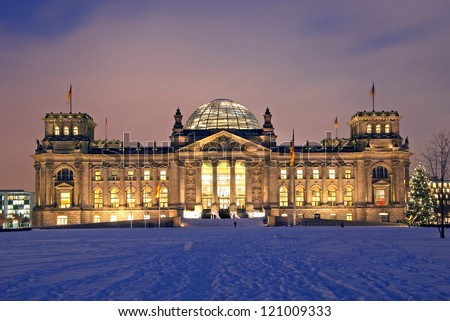 berlin reichstag building in winter with christmas tree - stock photo