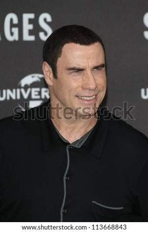 BERLIN - SEPTEMBER 17: John Travolta attends the 'Savages' photocall at Hotel Adlon on September 17, 2012 in Berlin, Germany. - stock photo