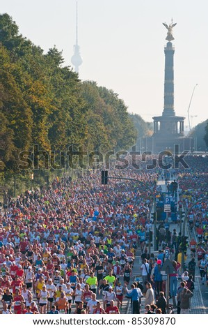 BERLIN - SEPTEMBER 25: Over 40,000 registered runners participate in the Berlin Marathon on September 25, 2011 in Berlin, Germany. - stock photo
