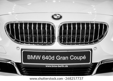 BERLIN - SEPTEMBER 09, 2012: Showroom. Detail of a Grand tourer / executive coupe BMW 640i Gran Coupe (F06) close-up. Black and white. Produced since 2012. - stock photo