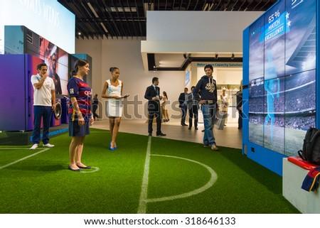 BERLIN - SEPTEMBER 04, 2015: Stand of company Beko. Interactive game of football. International radio exhibition Berlin (IFA2015). - stock photo