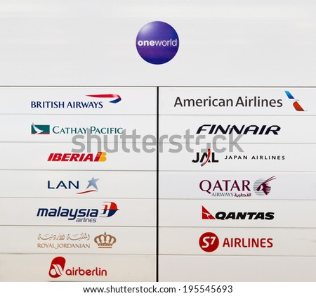 BERLIN TEGEL AIRPORT, GERMANY - APRIL 20: OneWorld alliance sign with all associated airlines in Berlin, Germany on April 20, 2014. OneWorld is one of the three biggest airline alliances. - stock photo