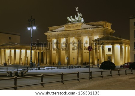 Berlin, the Pariser Platz with snow  and the illuminated Brandenburg gate at Christmas time.  - stock photo