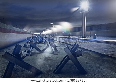 Berlin Wall - the inner area of the heavily guarded border line between East and West Berlin.It was built by the Soviet influenced Eastern side during the old War. - stock photo