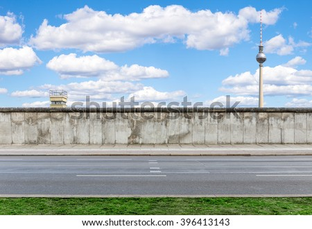 Berlin Wall with watchtower and TV Tower  - stock photo