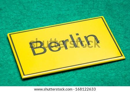 Berlin yellow card on a green floor - stock photo