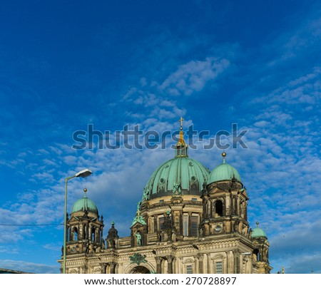 Berliner Dom or Berlin Dome on sunny day with birds flying around - stock photo