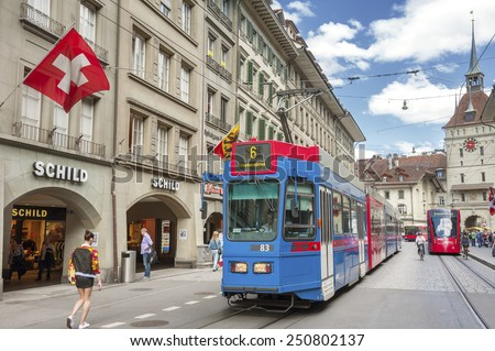 BERN, SWISS - MAY 24 : Streets in the old medieval city of Bern, Switzerland on May 24th, 2014. In 1983 the historic old town in the centre of Bern became a UNESCO World Heritage Site - stock photo