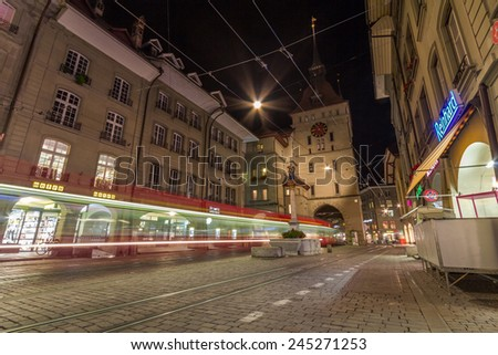 BERN, SWITZERLAND - OCT 24, 2014: Shopping alley with the famous clocktower of Bern on Switzerland. - stock photo