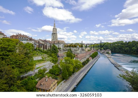 BERN, SWITZERLAND - SEPTEMBER 06, 2015: General view of Bern and the steeple of the cathedral towering over the city. The Capital City of Switzerland it is the 4th most populous city in Switzerland - stock photo