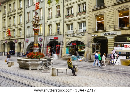 BERN, SWITZERLAND - SEPTEMBER 11, 2015: Musketeer (Schutzenbrunnen) fountain, dated on 16th century, located at Marktgasse. The city of Bern is worldwide known for its 16th century fountains - stock photo