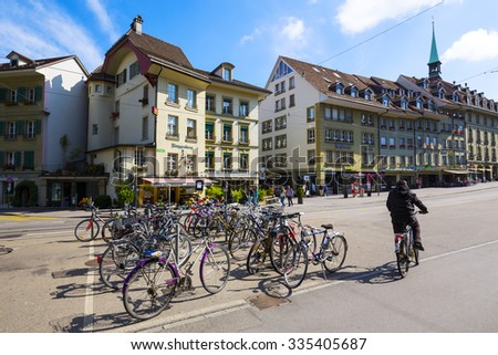 BERN, SWITZERLAND - SEPTEMBER 13, 2015: Parked bicycles at the sidewalk creates environment-friendly landscape of the city. Capital City of Switzerland it is the 4th most populous city in the Country - stock photo