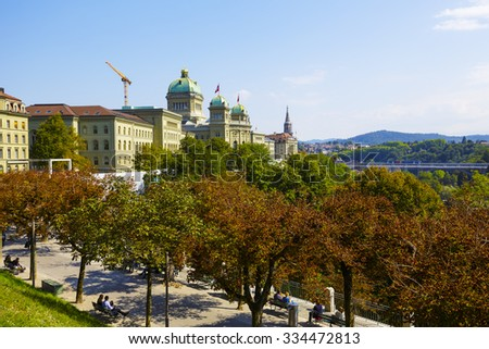 BERN, SWITZERLAND - SEPTEMBER 11, 2015: The Federal Palace, it is the seat of Federal Parliament (Swiss Federal Assembly), The Federal Council is housed here as well  - stock photo