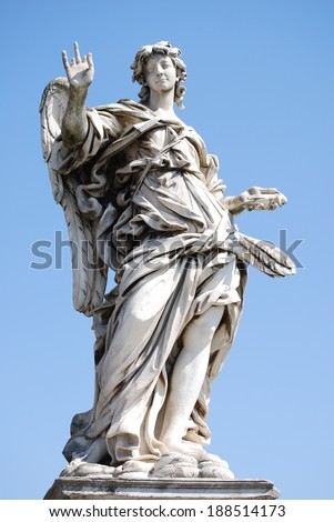 Bernini's marble statue of angel with cross from the Sant'Angelo Bridge in Rome - stock photo