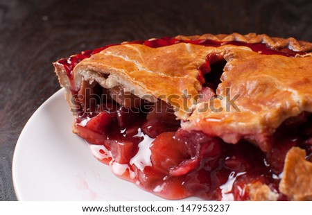 Berries and rhuharb pie crust cut - stock photo