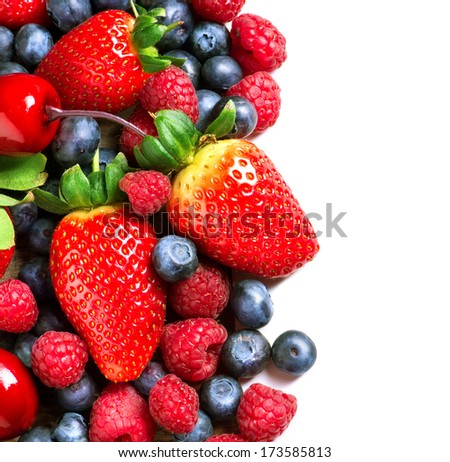 Berries border isolated on White Background. Summer or Spring Organic Berry closeup. Strawberries, Raspberries, Blueberry and Cherry. Agriculture, Gardening, Harvest Concept. Vitamin  - stock photo