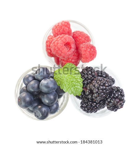 Berries in small glasses isolated over white top down - stock photo