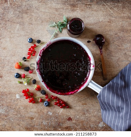 berries jam on the wood table - stock photo