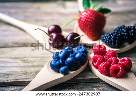 Berries on wooden rustic background - stock photo