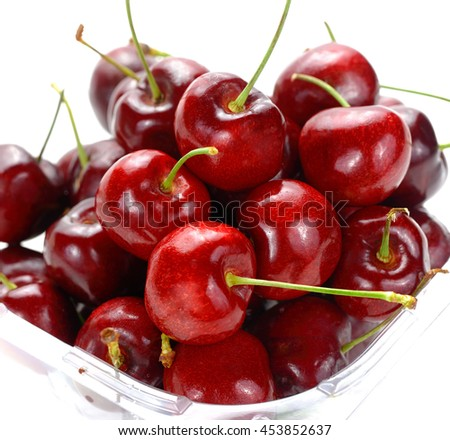 Berries ripe cherry on a white . Sweet cherry fruits in plastic box - stock photo