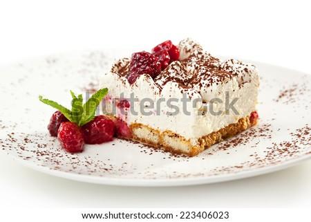 Berries Tiramisu Dessert with Cinnamon and Coffee. Garnished with Raspberry and Mint - stock photo