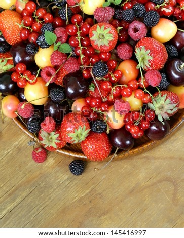 berry assortment - raspberries, blackberries, strawberries, currants, cherries - stock photo
