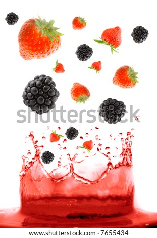berry falling in juice. Isolation. - stock photo
