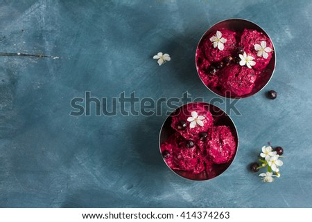 Berry ice cream or sorbet with fresh berry on vintage background, selective focus - stock photo