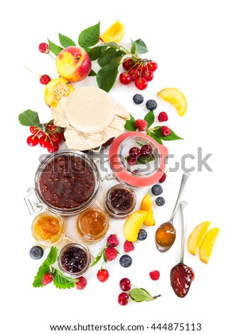 Berry jam in glass jars isolated on white background. - stock photo