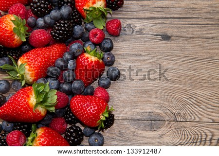 Berry over Wood. Strawberries, Raspberries, Blueberry - stock photo