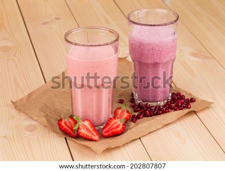 berry smoothies present in a glasses in the closeup - stock photo