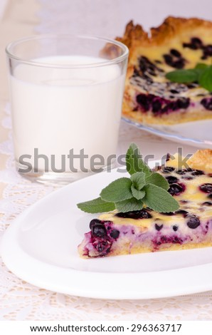 berry tart, a piece of blueberry pie with a glass of milk - stock photo