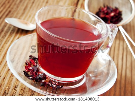 Berry Tea in Transparent Cup on Wooden Background, Delicious Tea Cup - stock photo