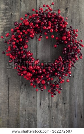 Berry wreath on wooden background - stock photo