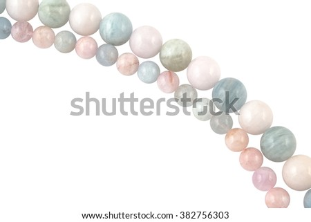 beryl crystal mineral gem beads sample on white background. - stock photo