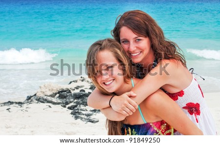 Best friends at the beach - stock photo