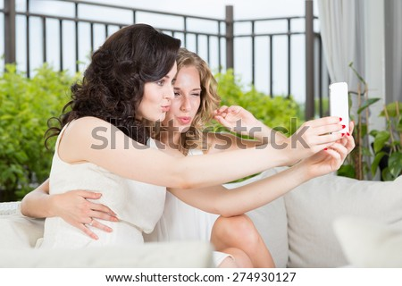 Best friends celebrating and taking selfie. - stock photo