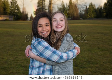 Best friends hugging outside - stock photo