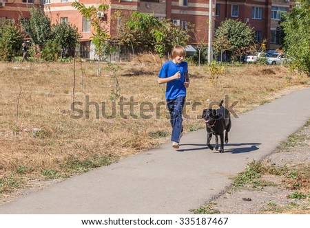 Best friends - Little boyl with dog at the nature - stock photo