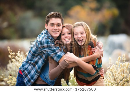 Best friends, teens laughing and hugging - stock photo