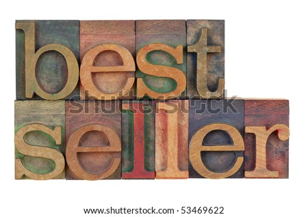 bestseller - word in vintage wood letterpress type blocks stained by color inks, isolated on white - stock photo