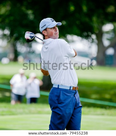 BETHESDA, MD - JUNE 14: Matt Kuchar hits a shot at Congressional during the 2011 US Open on June 14, 2011 in Bethesda, MD. - stock photo