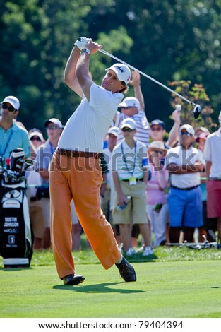 BETHESDA, MD - JUNE 14: Phil Mickelson hits a drive on Congressional during the 2011 US Open on June 14, 2011 in Bethesda, MD. - stock photo