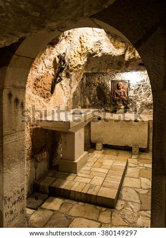 BETHLEHEM, Israel, July 12, 2015: The city of Bethlehem. Cross in the grotto of St. Jerome in the area of the Church of St. Catherine and close to the Basilica of the Nativity of the birth of Jesus  - stock photo